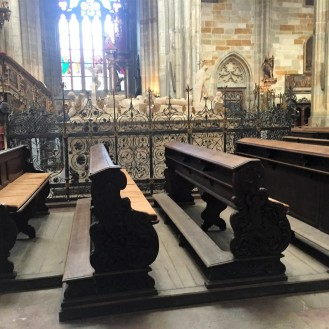 benches for worshipping; in the background stands the tomb of one of many Medieval kings burried here